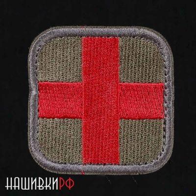 Шеврон красный крест на зеленом фоне